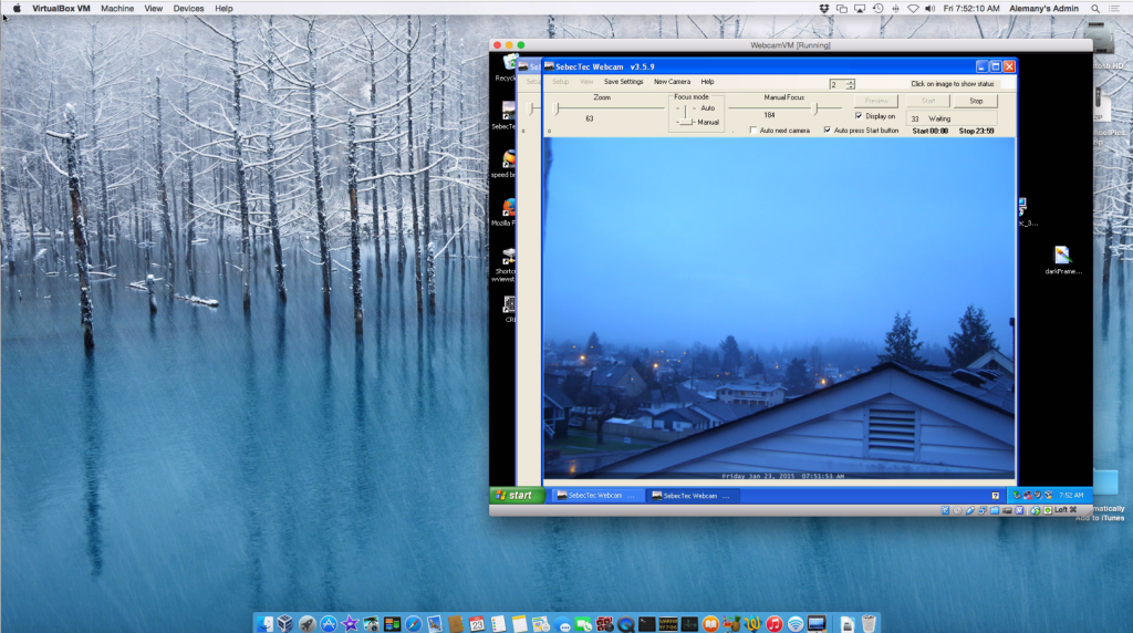 A screenshot of my Mac mini desktop showing the Virtual machine that exclusively runs WindowsXP for the webcam software.  I can control the Virtual machine through the Mac remotely and through scripts.